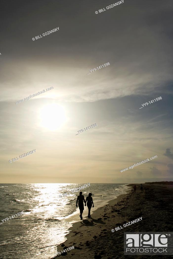 Stock Photo: Couple walking hand-in-hand down Bowman's Beach - Sanibel Island, Florida.