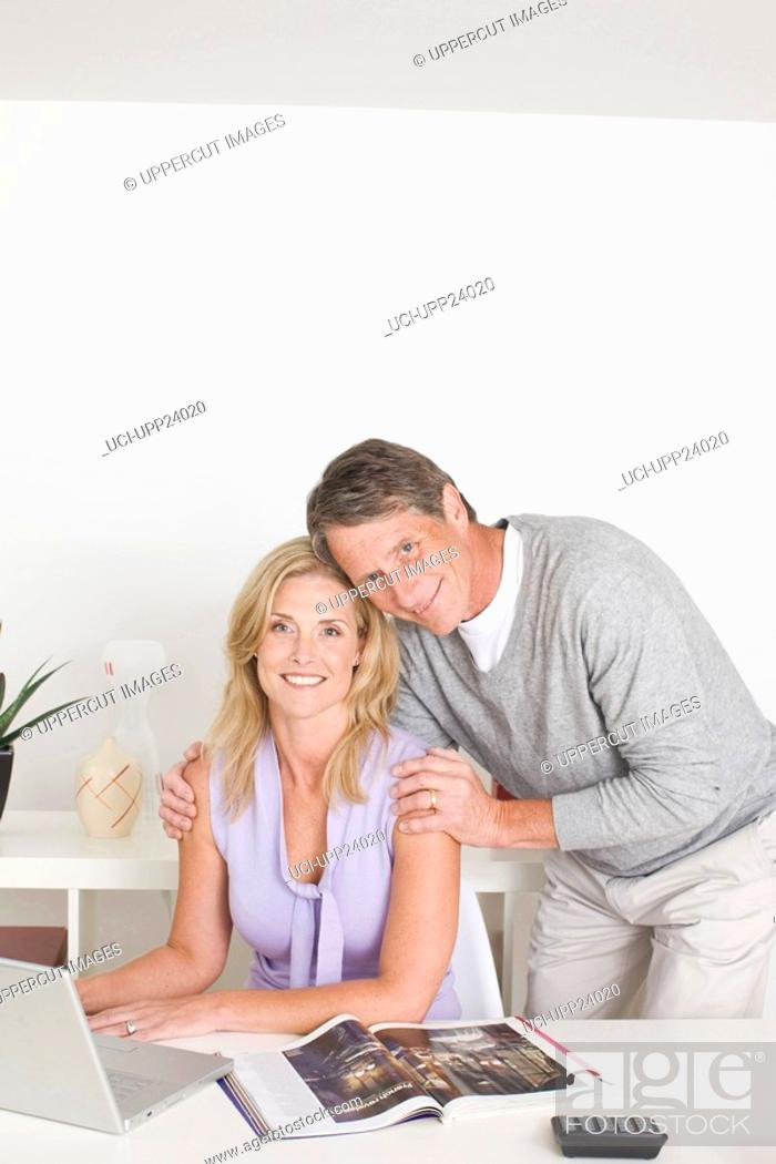 Stock Photo: Portrait of couple in home office.