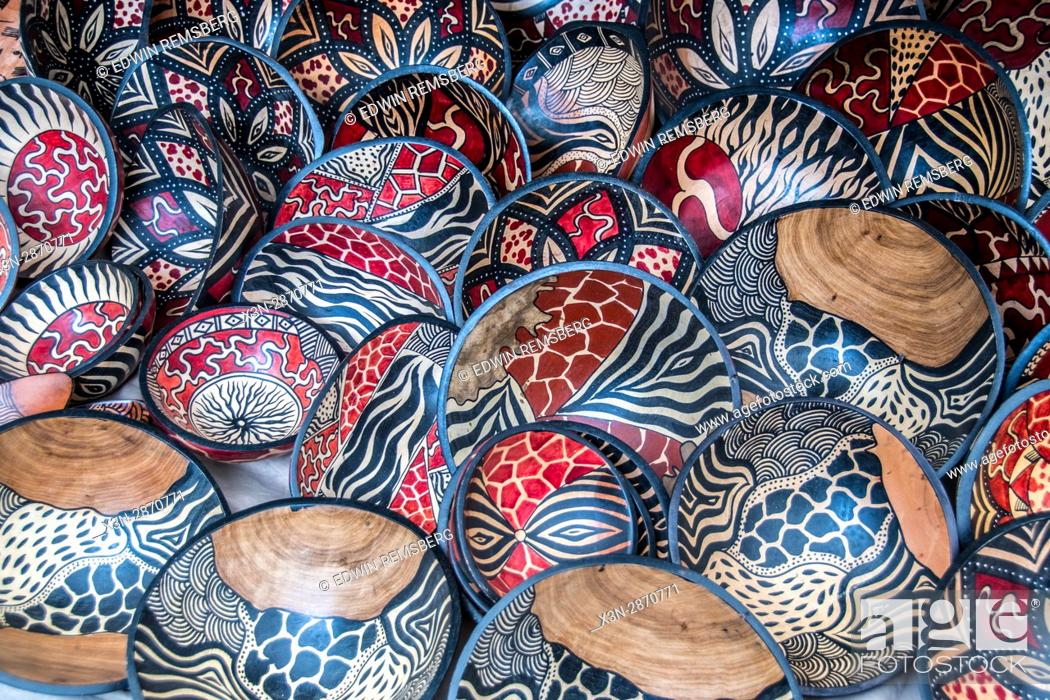 A Large Selection Of Wooden Hand Painted Bowls Are For Sale At An