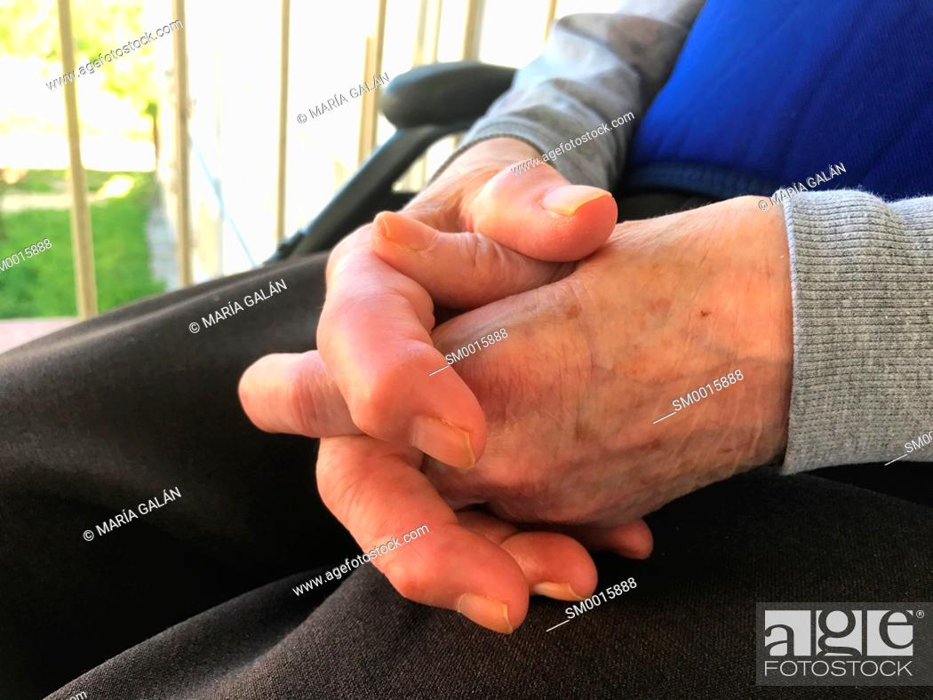 Stock Photo: Old woman' s crossed hands.