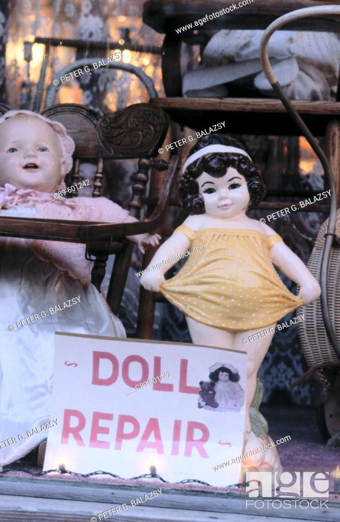 Stock Photo: Dolls in shop window.