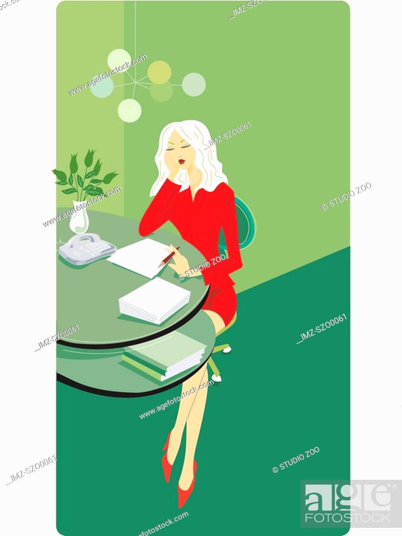 Stock Photo: Businesswoman sitting at her desk and writing a report.