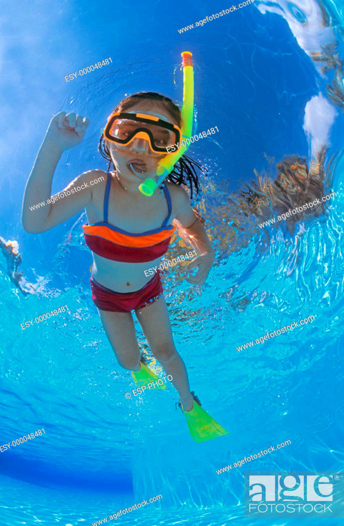 Stock Photo: Underwater view of young girl snorkeling. Mayan Riviera, Mexico.