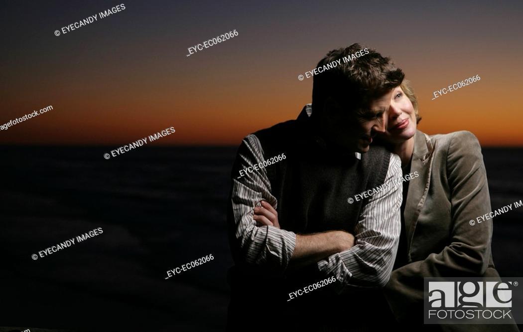 Stock Photo: Mature couple embracing.