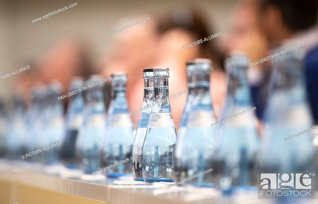 Stock Photo: 18 February 2020, Baden-Wuerttemberg, Stuttgart: Mineral water bottles from Mineralbrunnen Teinach GmbH stand on a table during a press conference of Daimler.