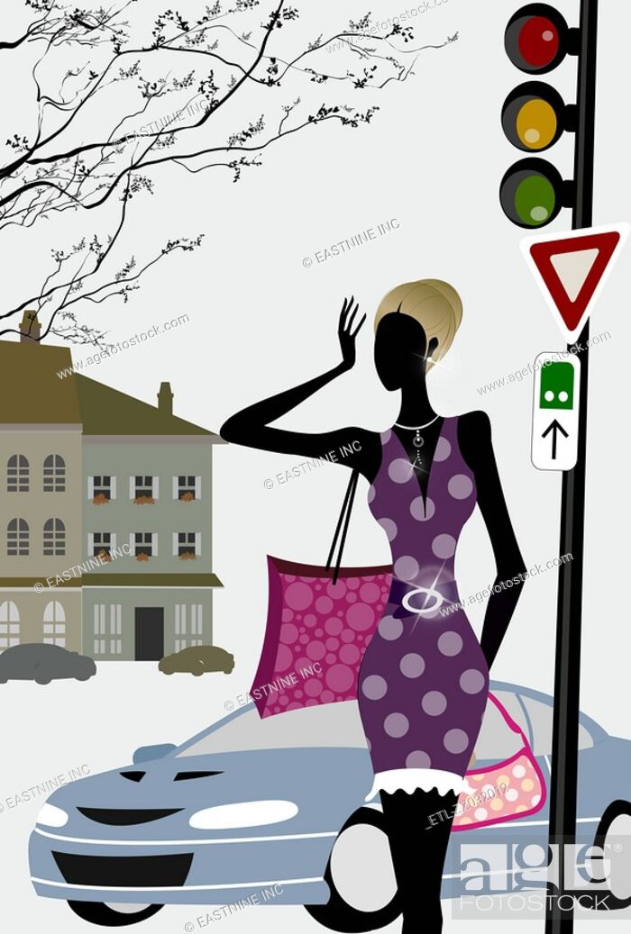 Stock Photo: Woman standing at a traffic light.