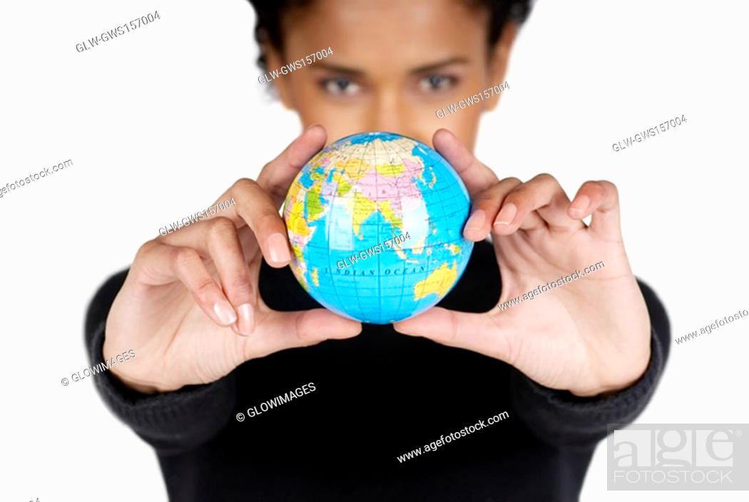 Stock Photo: Portrait of a businesswoman holding a globe.