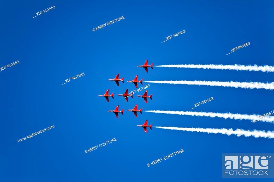 Stock Photo: England Devon Royal Air Force Red Arrows aerobatics display at Dartmouth Regatta.
