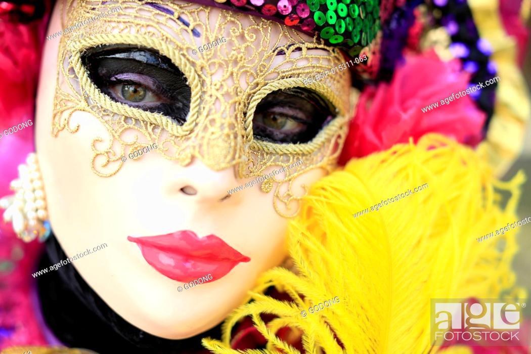 Stock Photo: Yvoire, labelled Les Plus Beaux Villages de France (The Most Beautiful Villages of France). The Venitian carnival. Woman wearing carnival costume.