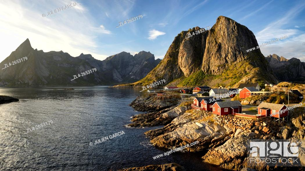 Stock Photo: Norway, Nordland, Lofoten islands, Moskenesoy island, the fishing village of Hamnoy, traditional fishermen cabins built on stilts (rorbu, rorbuer) at sunset.