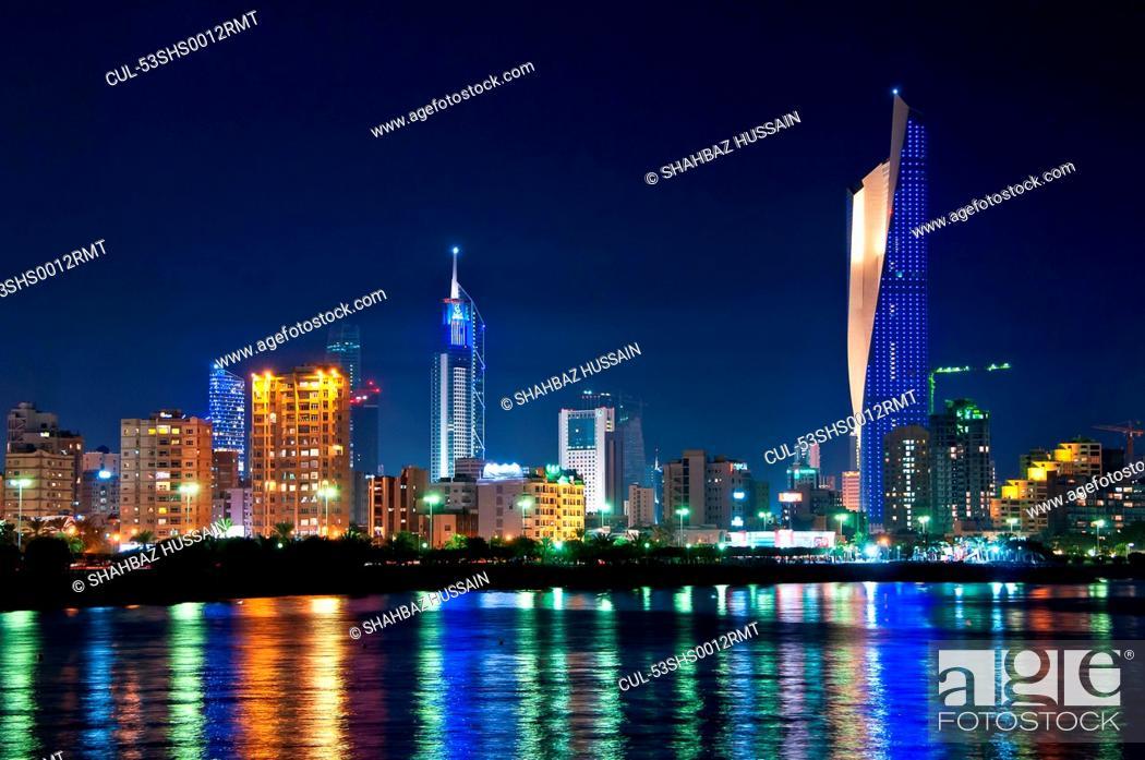 Stock Photo: Kuwait City skyline reflected in water.
