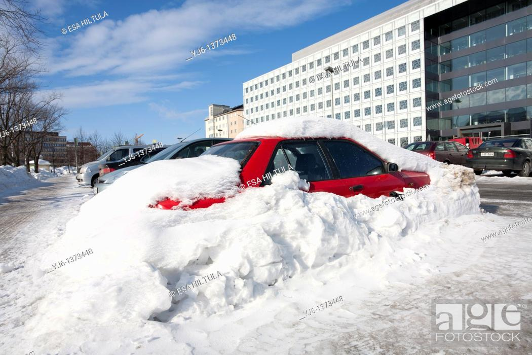 Stock Photo: red car buried in snow Helsinki Finland.