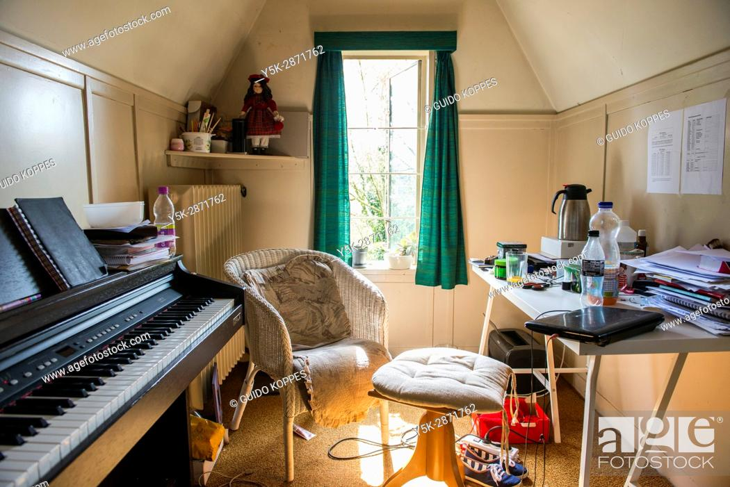Stock Photo: Tilburg, Netherlands. Attic room interior of a classical singing and music teacher's rehearsal room.