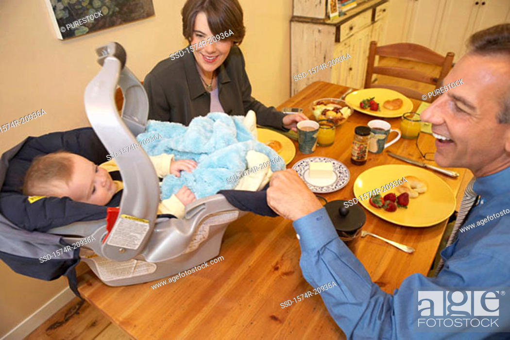 Stock Photo: High angle view of a mid adult couple playing with their son.