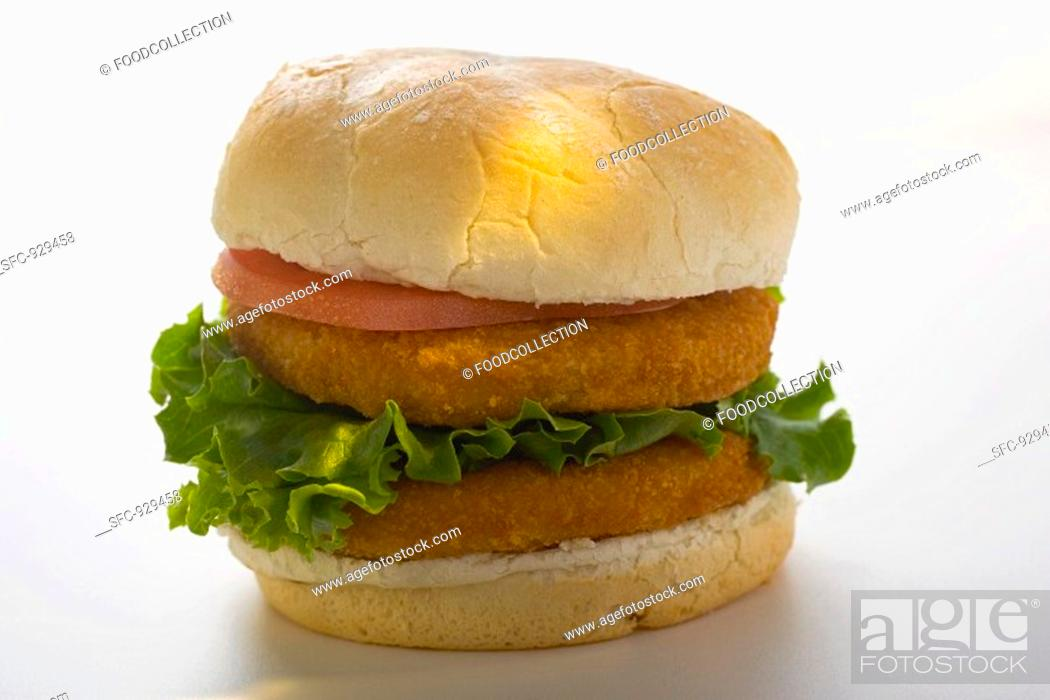 Stock Photo: Double chicken burger with tomato and lettuce.