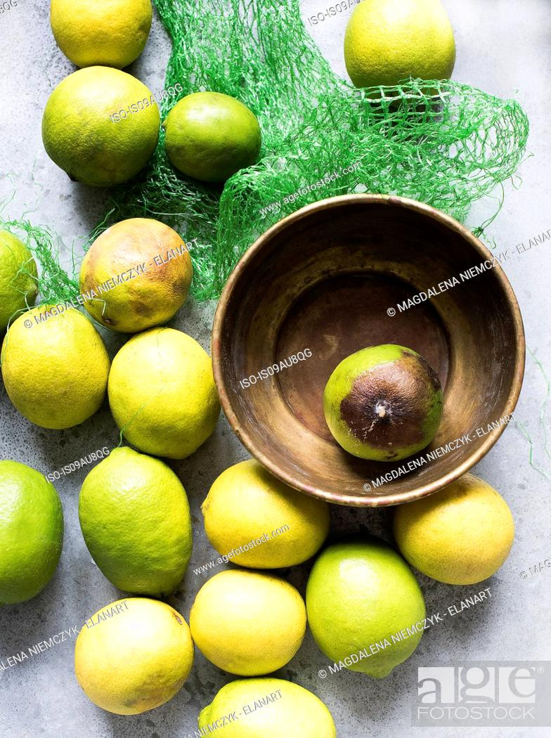 Stock Photo: Overhead view of lemons in bowl and net packaging.