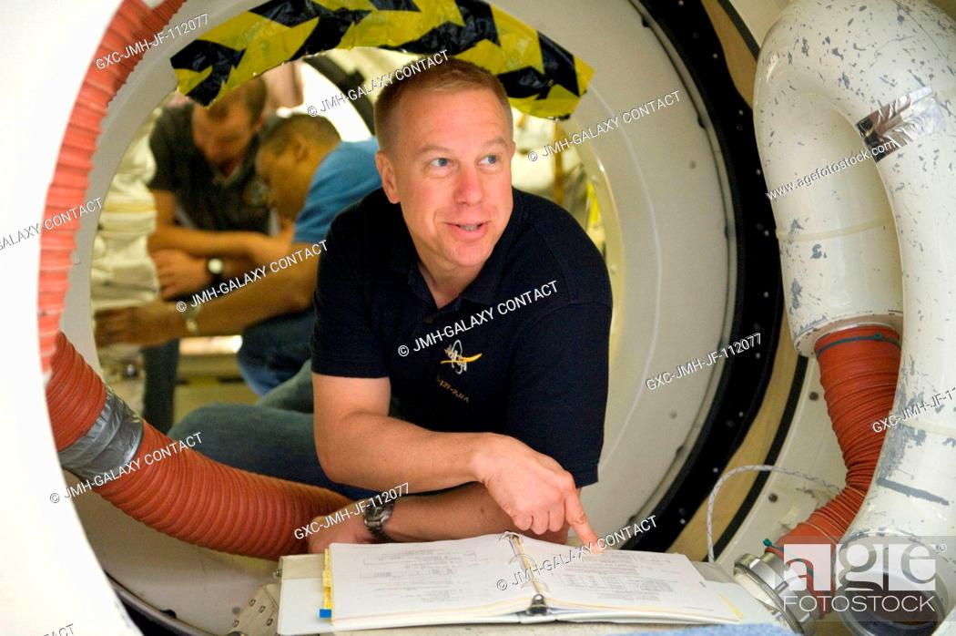 Stock Photo: NASA astronaut Tim Kopra, STS-133 mission specialist, participates in a training session in an International Space Station mock-uptrainer in the Space Vehicle.