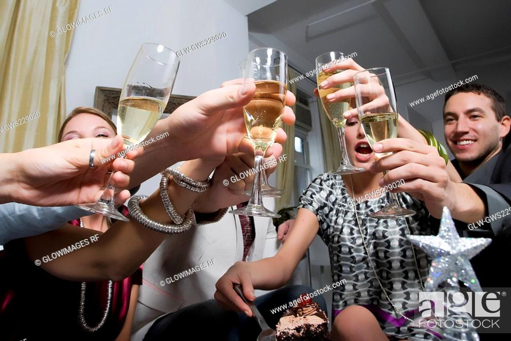Stock Photo: Low angle view of a young woman celebrating birthday with her friends.