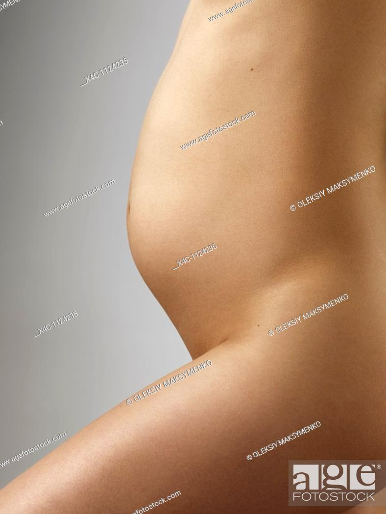 Stock Photo: Closeup of a pregnant young woman belly  4 months of pregnancy.