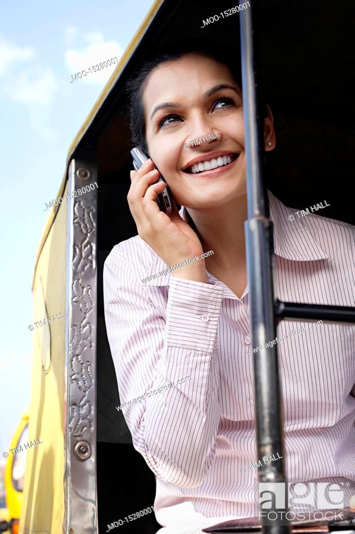 Stock Photo: Business woman on cell phone smiling.
