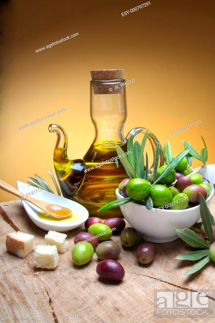 Stock Photo: Tasting olive oil and freshly harvested olives.