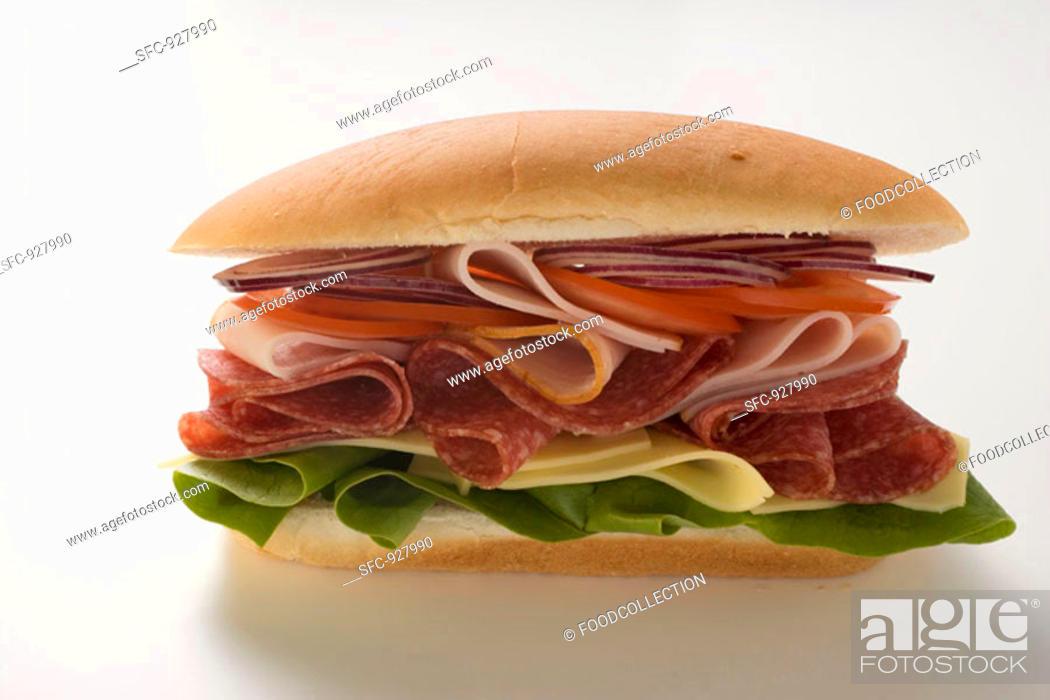 Stock Photo: Salami, ham, cheese and salad sandwich.