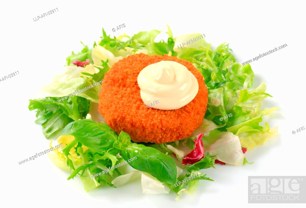 Stock Photo: Fried cheese with green salad and mayonnaise.