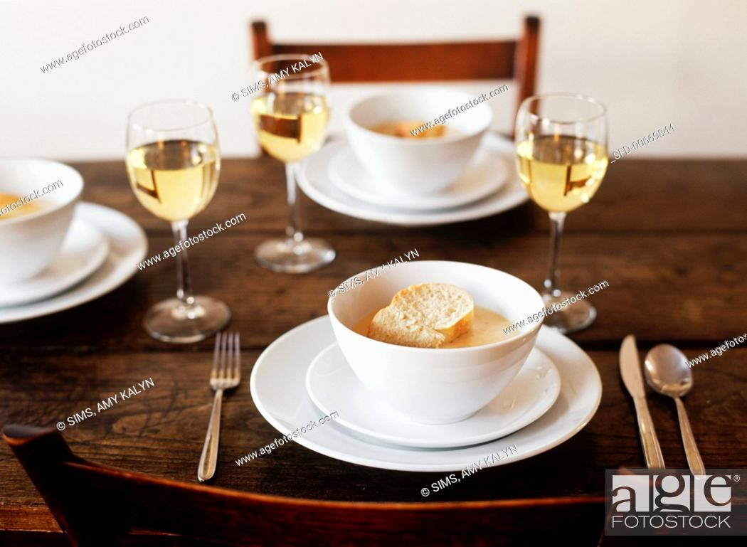 Stock Photo: Table Set with Bowls of Lobster Bisque Topped with Bread; White Wine.