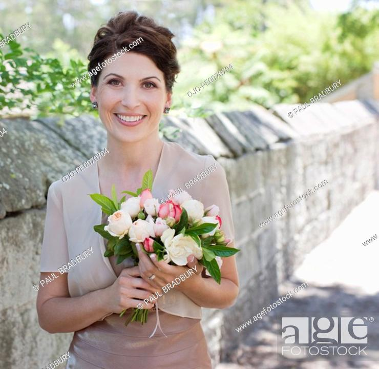 Stock Photo: Mature bride holding bouquet.