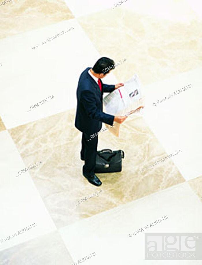 Stock Photo: Arab businessman reading newspaper.
