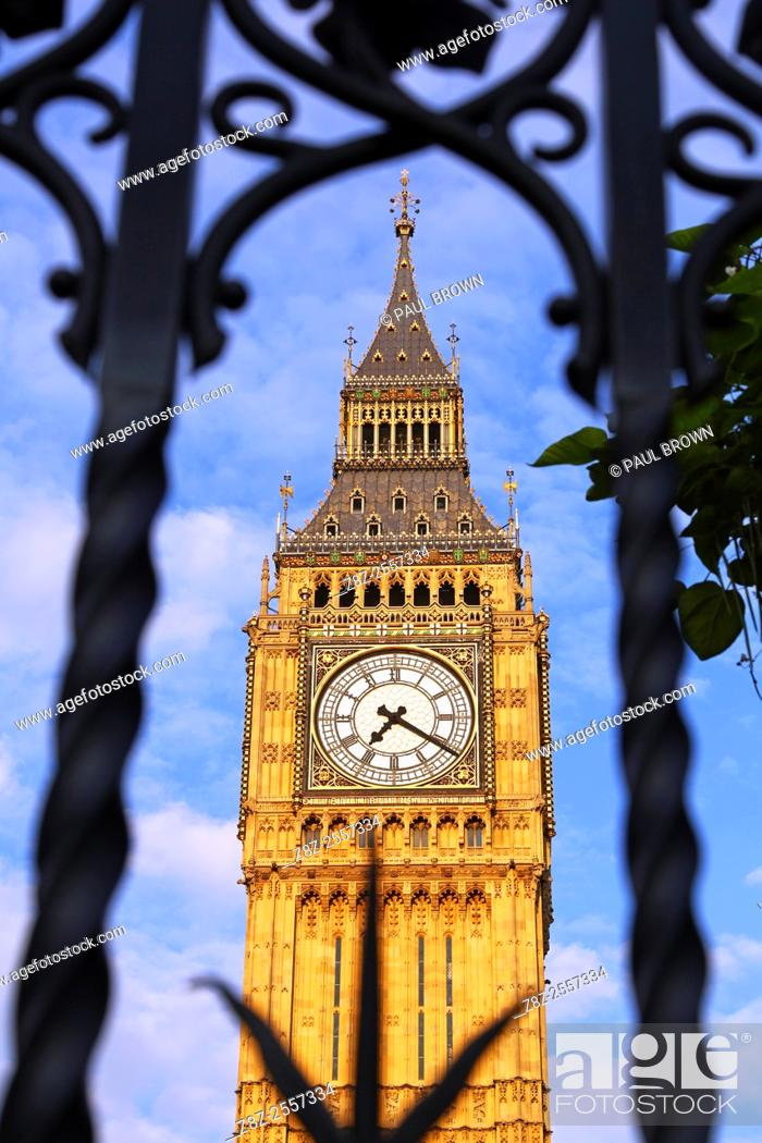 Stock Photo: Big Ben, Houses of Parliament seen through railings in London, England.