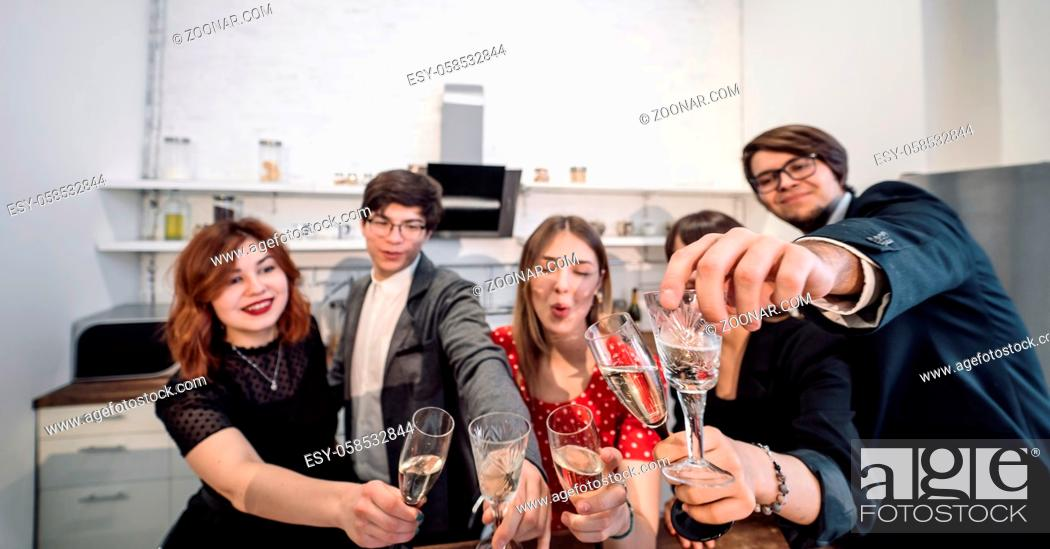 Photo de stock: Happy colleagues in office celebrate special event together, smiling diverse work team have fun laugh. Friendship concept.