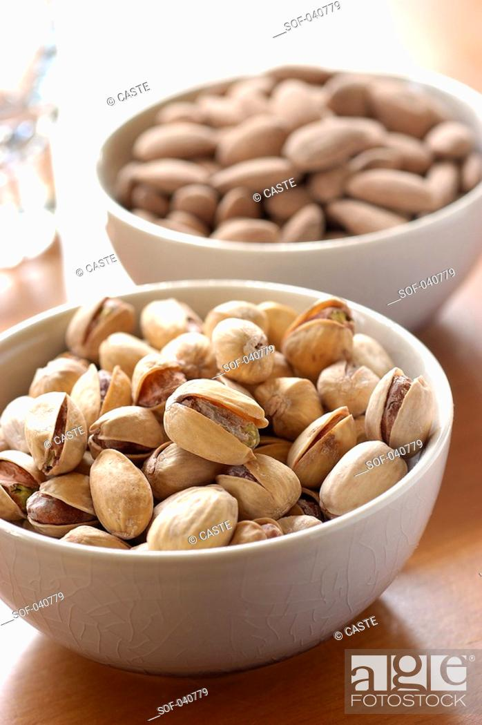 Stock Photo: pistachios and almonds.