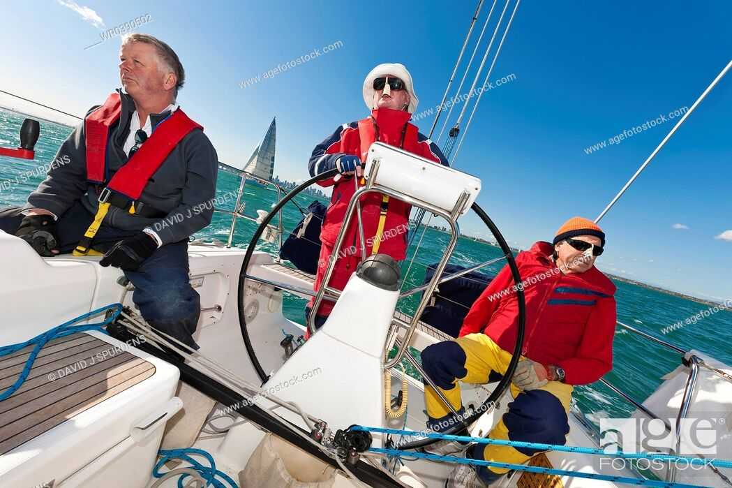 Stock Photo: The captain at the wheel of an Ocean going yacht getting ready to race.