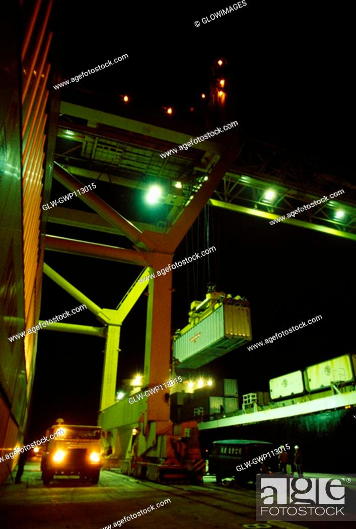 Stock Photo: Crane lifting a container at marine terminal, Hong Kong, China.