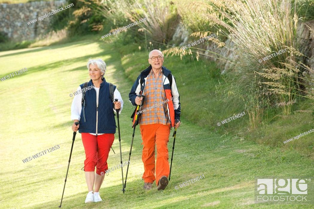 Stock Photo: Spain, Mallorca, Senior couple nordic walking.