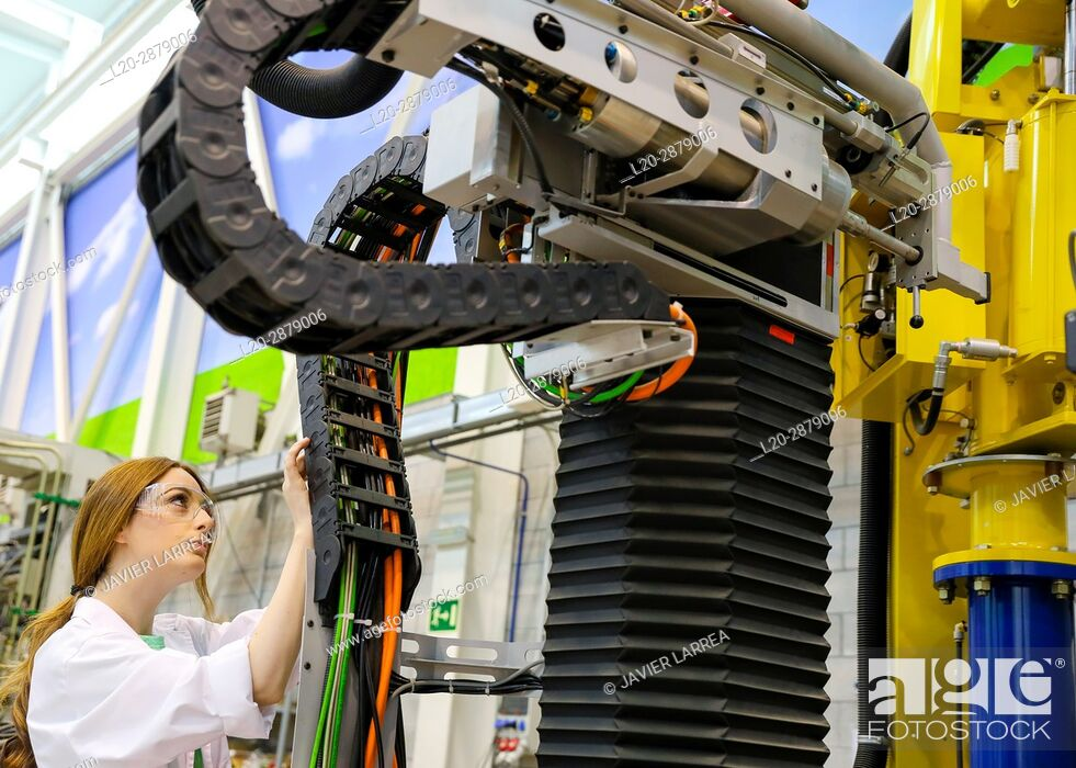 Stock Photo: Robotic mobile platform for aeronautical drilling. Researcher working on portable robot to drill holes into aircraft components, Industry.