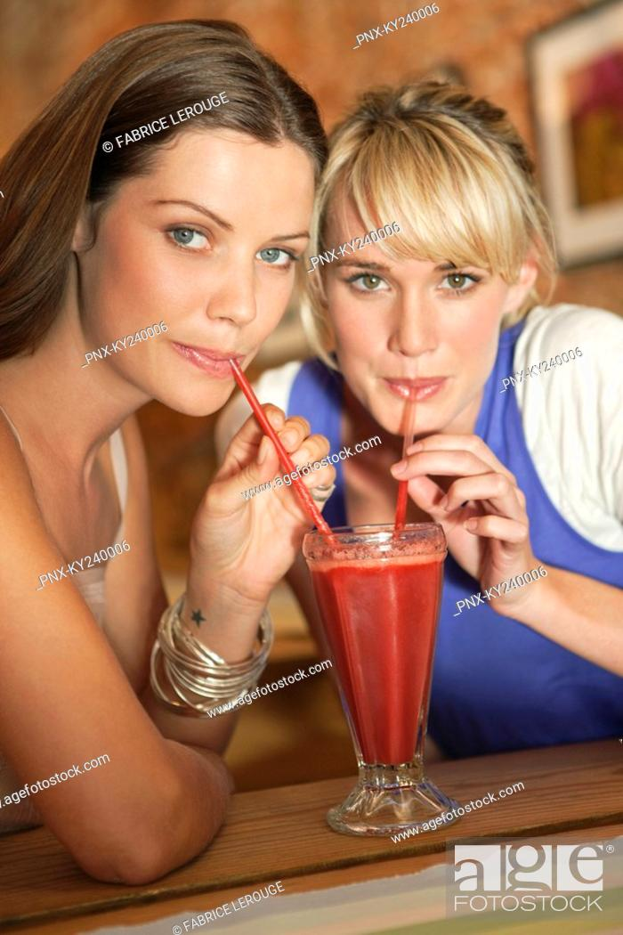 Stock Photo: Two women drinking bloody mary in a cafe.