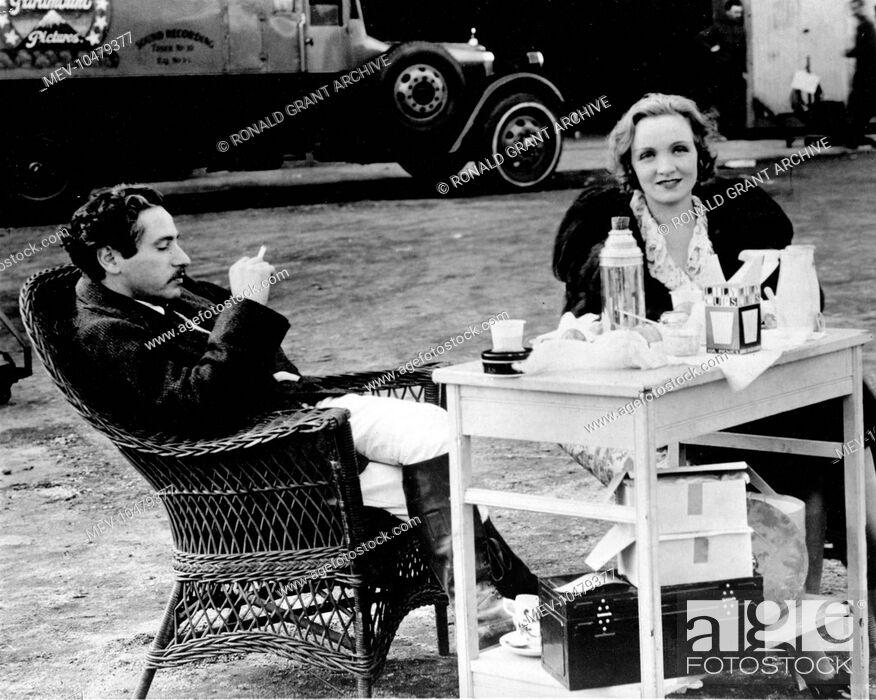 Stock Photo: JOSEF VON STERNBERG , Austrian born film director, off set with MARLENE DIETRICH , German born actress.