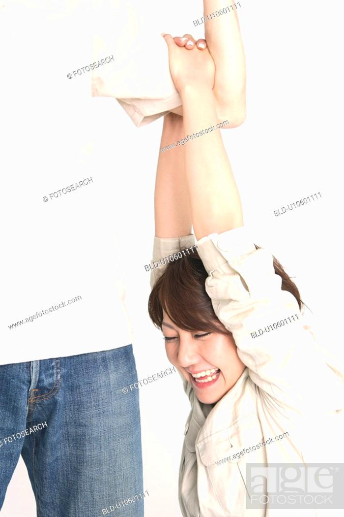 Stock Photo: Woman hanging from an arm.