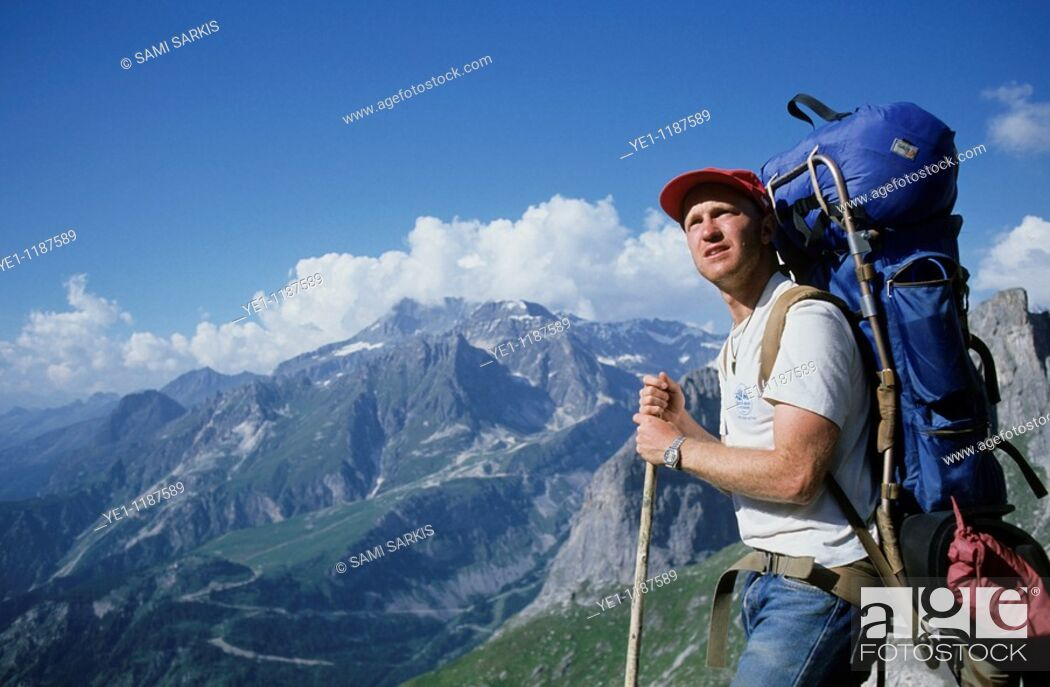 Stock Photo: Male hiker contemplating a mountainous landscape.