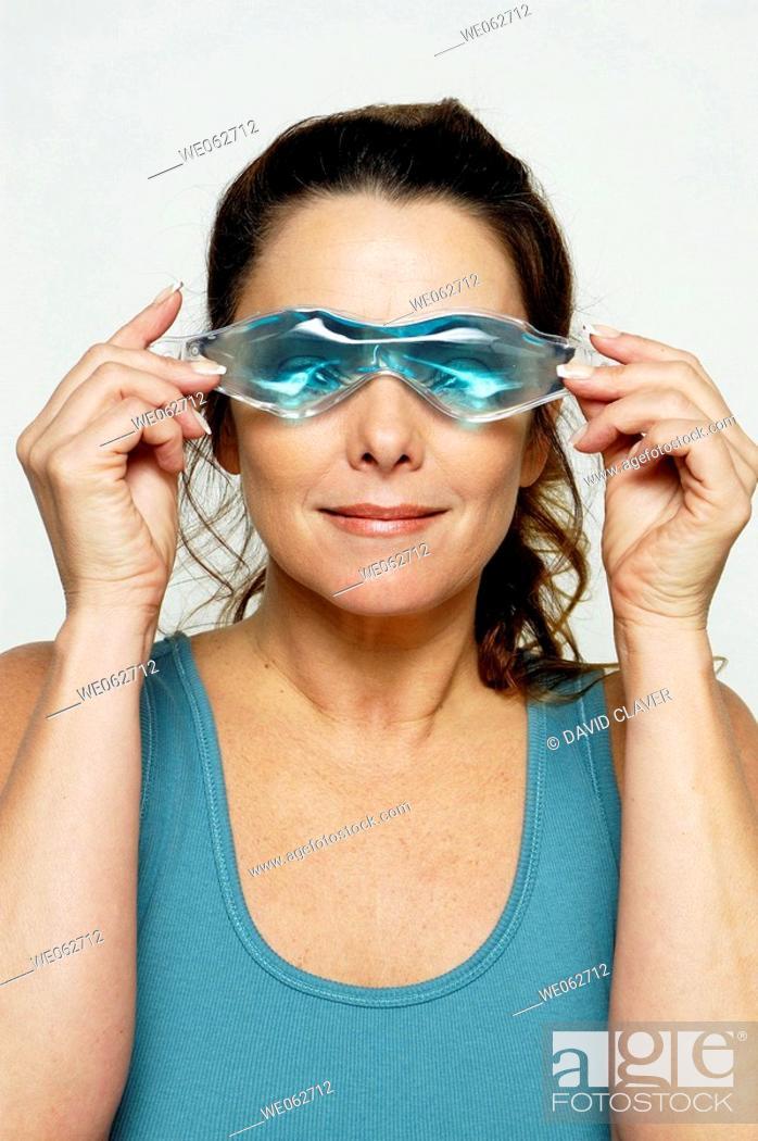 Stock Photo: Woman with eye mask.