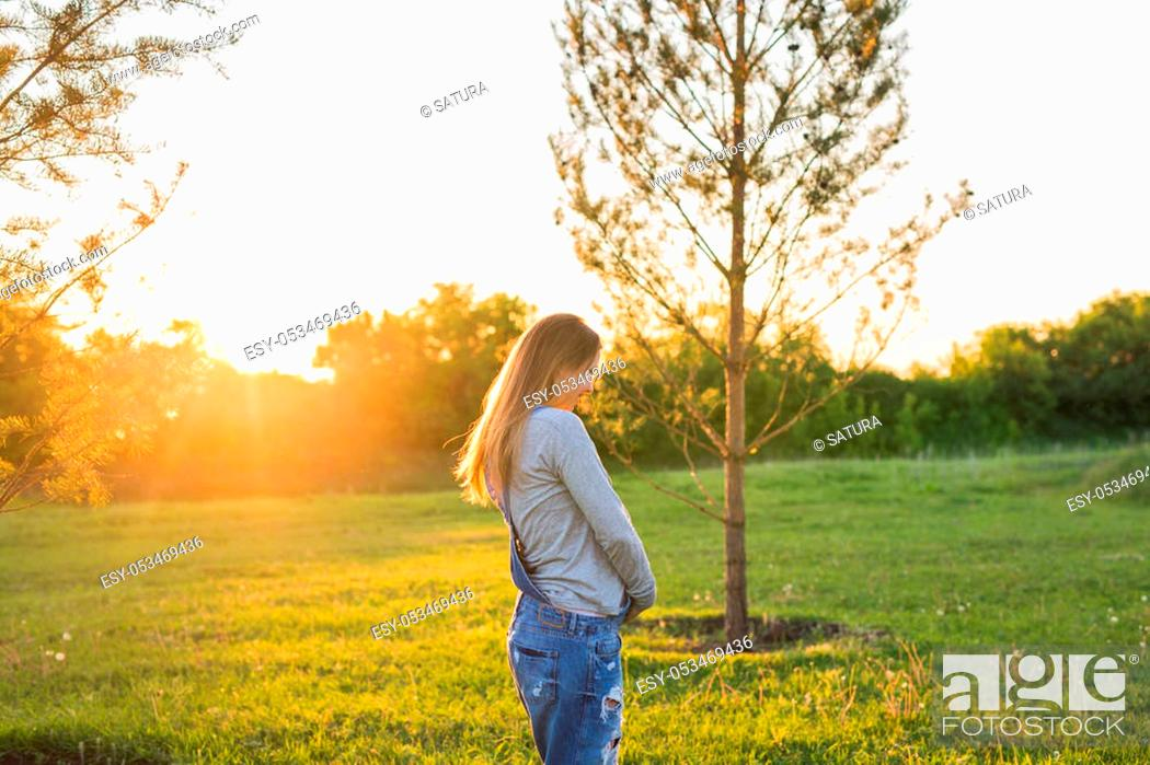 Stock Photo: young happy pregnant woman relaxing and enjoying life in autumn nature.