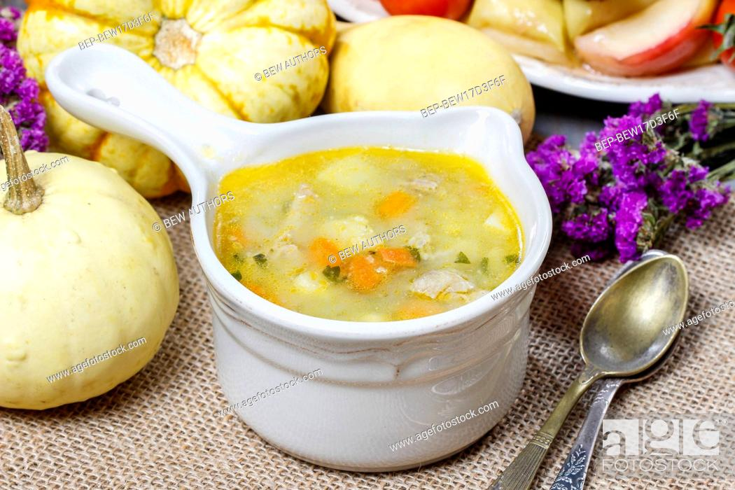 Stock Photo: Chicken soup with noodle and vegetables.