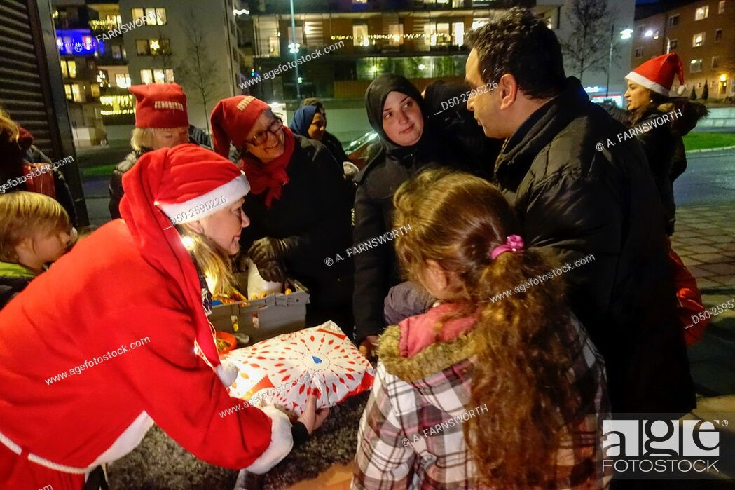Stock Photo: STOCKHOLM SWEDEN Local help organization Care & Share delivering Christmas presents to newsly arrived refugees.
