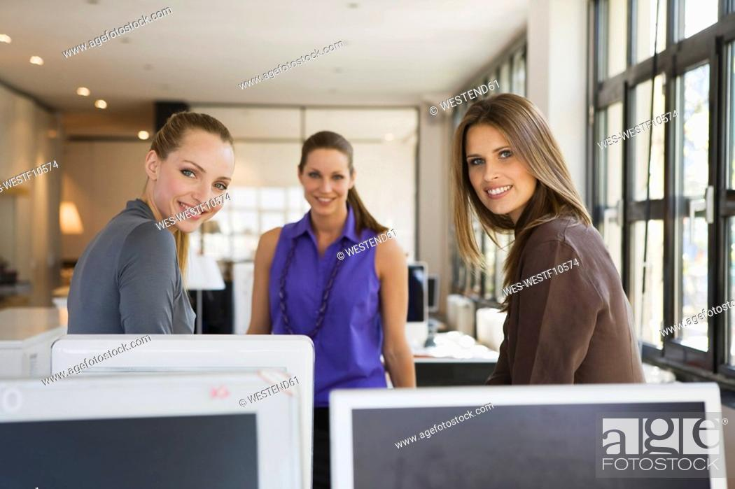 Stock Photo: Three women in office.