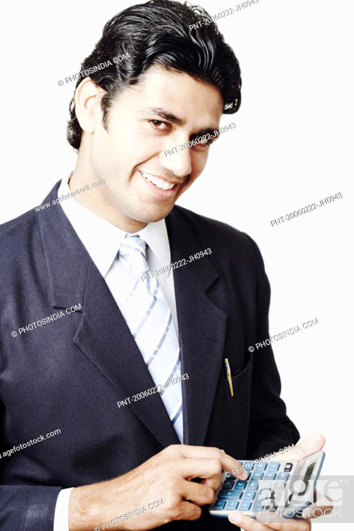 Stock Photo: Portrait of a businessman holding a calculator.
