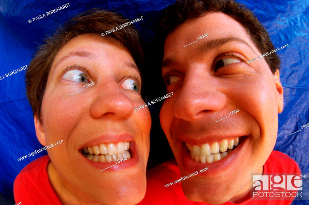 Stock Photo: Funny portrait of couple grinning at each other.