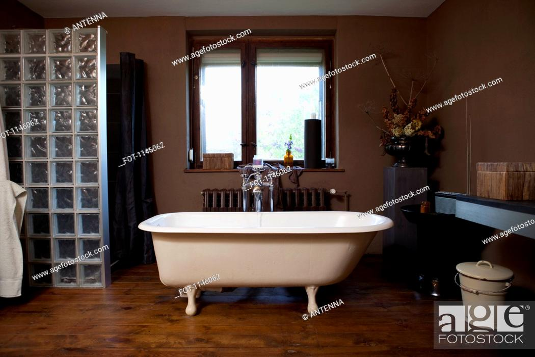 Stock Photo: Water running into a claw foot bathtub.