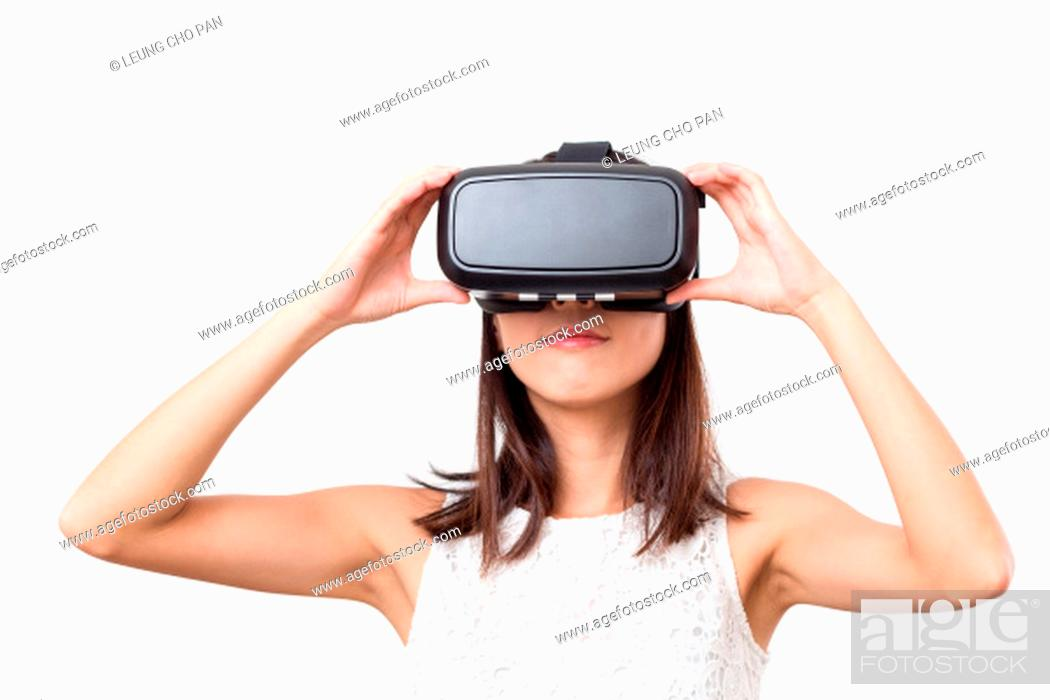 Stock Photo: Woman looking though VR device.